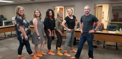 RISE Office party Orange Socks day